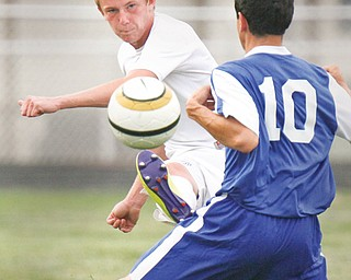 Lakeview's Matt Pasternak (2) kicks around Hubbard's Chris Colella (10) during their soccer game Wednesday at Lakeview in Cortland. The Bulldogs shut out the Eagles, 5-0.
