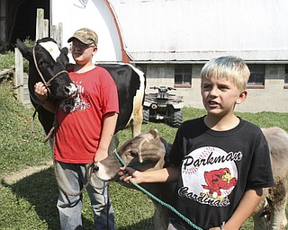 William d LEwis The Vindicator Steve Turon, 14,left, and his brother Colby, 9, on their fmily's West Farmington farm.