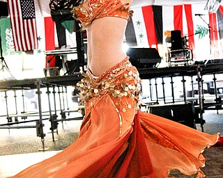 MADELYN P. HASTINGS | THE VINDICATOR..Ameera Paone belly dances at the Arab American Community Festival in downtown Youngstown on Saturday, August 24, 2013.... - -30-..