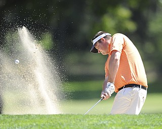 Golfer Steve Smoot of Brookfield chips out of the sand trap and onto the green on the 8th hole Saturday afternoon at Youngstown Country Club as part of the Vindy Greatest Golfer tournament on August 24.