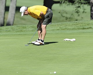 Golfer Albert Pacella of Struthers reacts after watching his putt miss the cup by inches on the 17th hole Saturday afternoon at The Lake Club as part of the Vindy Greatest Golfer tournament on August 24.