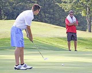 Bryce Miner watches his putt to the hole on the sixth hole of The Lake Club in Poland during rhe Greatest Golfer of the Valley tournament on Sunday.  Dustin Livesay  |  The Vindicator  8/25/13  Poland.
