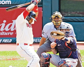 The Indians' Carlos Santana, leans away to avoid being hit by an inside pitch during the fifth inning of a
