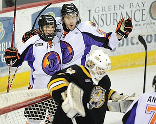 Youngstown Phantoms forward John Padulo (57), middle, and a teammates celebrate a first-period goal against the Green Bay Gamblers during a USHL playoff game. Padulo has been invited to the San Jose Sharks' rookie training camp.