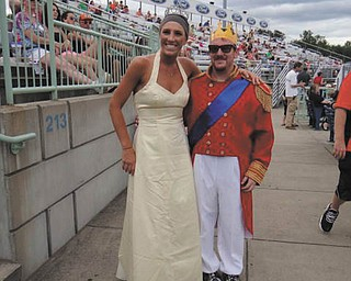 Chrissy Toth, of Austintown, and a Scrappers worker, Chris Sumner, enjoyed the Mahoning Valley Scrappers game July 14, Princess Day.
