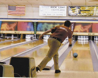 Professional bowler Ken Yokobosky, shown in action at Bell-Wick Bowl, Hubbard, in March. Sent to us by Doxie Damico of Austintown.