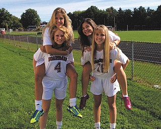 Four juniors on the Boardman High School Girls Soccer team, from left, No. 4 Kristen Huck (goalie) with No. 13 Alison Green on her back and No. 16 Alexis Downie with No. 40 Heaton O'Hara on her back, hope to have another successful season and make it to the district championships again.