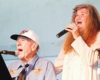 Jackie and Mary Ruth Robinson sing in the Robinson Family Band at the Canfield Fair, which began Wednesday. The Robinson family has been performing at the fair for 22 years.