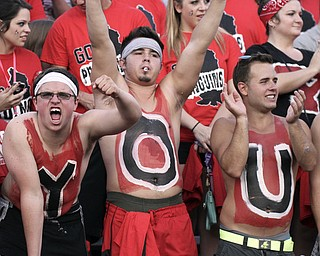 William d Lewis The Vindicator  YSU students l-r Ansel Morsillo, Tyller(CORRECT) Schonce and Jason Heyman show their penguin spiriit during opener Thursday with dayton. They and other students spelled YOUNGSTOWN on thier chests.