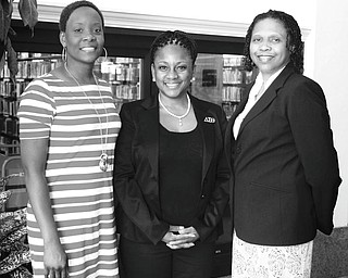 MADELYN P. HASTINGS | THE VINDICATOR: From left, Chantelle Hallman; Dr. Michelle McCollin, chapter president; and Dr. Sherri Lovelace-Cameron gather in the Youngstown Main Library to promote Delta Sigma Theta's 100th anniversary Black Excellence banquet.
