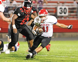 Struthers' Michael Sullivan (41) makes a cut and eludes Campbell Memorial's Keith Jenkins (57) on a third-quarter