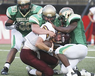William D LEwis The Vindicator  Walsh Jesuit QB Pat Ford(5) gets sacked by Irish ShaHaun Williams(50) Giacamo Cappabianca(55) and Kimauni Johnson(3) during 1rstr qtr action Friday at YSU.