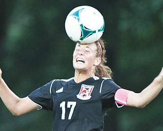 Canfield's Emma Sybert (17) heads the ball during action Wednesday night during a match against All-American Conference rival Howland. Canfield won, 2-1.
