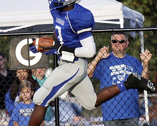 William DLewis The Vindicator  Hubbard's LJ Scott(3) scores during 1rst qtr action against Girard 9-6-13 at hubbard.