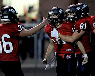 Fitch #10 Gabe Chepke celebrates with teammates #81 Austin Hogan and #36 C.J. Martini after scoring a rushing touchdown in the first half of a game on Friday September 6, 2013.