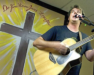 Matt Minnick of Newton Falls sings one of his original Christian songs during a recent Saturday praise and worship service at Second Chance Ministry. The ministry is moving from its current Austintown location to 3415 Canfield Road, Youngstown. Minnick will sing there Sept. 28.