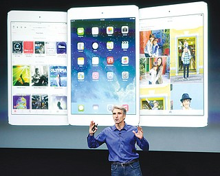 """Craig Federighi, senior vice president of software engineering at Apple, speaks during the new-product release in Cupertino, Calif., on Tuesday.Apple's latest iPhones will come in a bevy of colors and two distinct designs, one made of plastic and one that aims to be """"the gold standard of smartphones"""" and reads your fingerprint."""