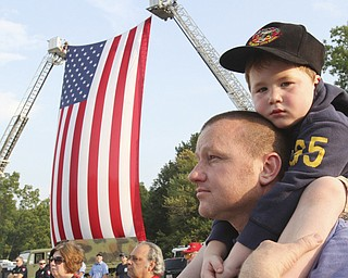 William D. Lewis The Vindicator Ken Blair of Youngstown and his son Mikey, 4,  during 9-11 ceremony in Austintown Wed.