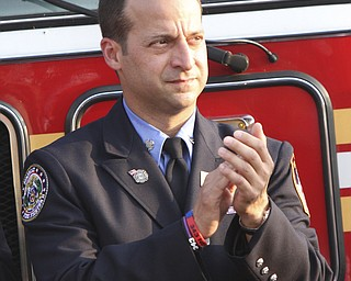 William D. Lewis The Vindicator Nick Mincone a New York City firefighter spoke during 9-11 ceremony in Austintown Wed.