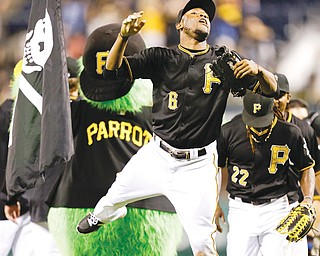 Pirates left fielder Starling Marte (6) celebrates Pittsburgh's 3-1 win over the Chicago Cubs as he heads for the dugout after Thursday's game in in Pittsburgh.