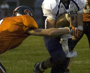 Kelli Cardinal/The Vindicator .Lowellville junior Phil Ginnis avoids the tackle Friday night against Springfield defender Ian Grdina (ok) at Springfield High School.