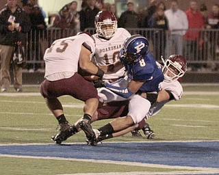 .          ROBERT  K. YOSAY | THE VINDICATOR..Boardmans #15  Gavin Dill Rips the ball from polands #8 Geroge Chammas after a pass and a gain to the 50  tackling George is  #14 Matt Filipovich and looking on is #10 Turel Thompson during third quarter action.Boardman Spartans at Poland Bulldogs Stadium