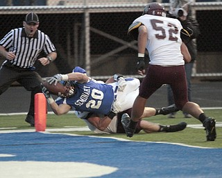 .          ROBERT  K. YOSAY | THE VINDICATOR..Polands #20  Ross Gould  Drags BDM #14 Matt Filipovich and #52 Alex Birchfield as he dives into the endzone for a score.Boardman Spartans at Poland Bulldogs Stadium