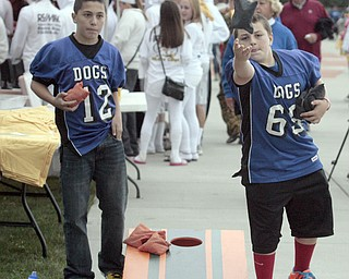 .          ROBERT  K. YOSAY | THE VINDICATOR..Andrew Parket and Zach Ellis Both from Poland and 11 years old get into a good game of Corn Hole..Boardman Spartans at Poland Bulldogs Stadium