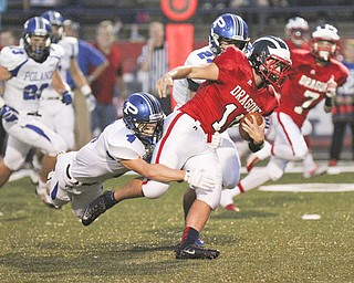 William D Lewis The Vindicator  Niles John Cicero (11) is stopped by Poland's Dylan Garver(4) during first quarter action Friday 9-20-13 action at Niles.