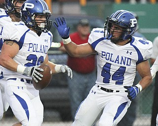 William D Lewis The Vindicator  Poland's Ross Gould (20) gets congrats from Jake Aiello (44) after scoring during first quarter action Friday 9-220-13  at Niles.