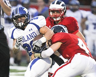 William D Lewis The Vindicator  Poland's Ross Gould(20) is stopped by Niles Tyler Srinovich (40) during first quarter action Friday 9-20-13 action at Niles.