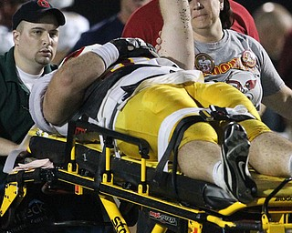 Youngstown Cardinal Mooney's Nick Bilas raises his fist as he is removed from the field after he was injured playing against St. Vincent - St. Mary's in the second quarter of a high school football game at St. Vincent - St. Mary High School on Friday, Sept. 20, 2013, in Akron, Ohio. (Michael Chritton/Akron Beacon Journal)