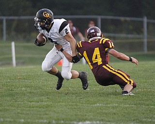 .          ROBERT  K. YOSAY | THE VINDICATOR..First Quarter action  as Crestveiws#2 Trevor Cope breaks free of SR #14   Bryce Allen as he runs around end for a first downCrestview @ South Range in North Lima