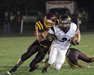 .          ROBERT  K. YOSAY | THE VINDICATOR..Crestvies #2 Trevor Cope is corraled by SR  #14 Bryce Allen  as he came around end during second quarter action stopping him before getting a first down..Crestview @ South Range in North Lima