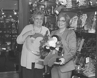 SPECIAL TO THE VINDICATOR The Youngstown Symphony will host its annual trunk show and sale Oct. 5. Above are Mercy Komar,  left, committee chairwoman, and Monica Rafoth, representing Adamas Jewelry and Gifts, one of  several vendors.