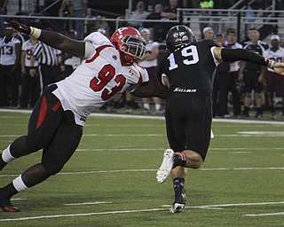 Youngstown State defensive tackle Emmanual Kromah (93) gets a grip on Southern Illinois University's quarterback Kory Faulkner (19) during the first quarter of Saturday's matchup at Southern Illinoi University in Carbondale Illinois.  Dustin Livesay  |  The Vindicator  9/28/13  Carbondale Illinois.