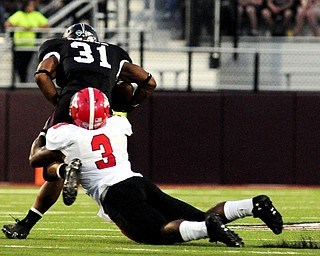 Youngstown State's Teven Williams tries to drag down Southern Illinois' Malcolm Agnew during the first half of the teams game at Saluki Stadium on Saturday, Sept. 28, 2013, in Carbondale, Ill. (Paul Newton / The Southern)