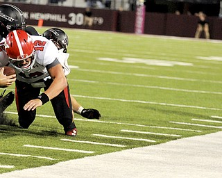 Youngstown State's Kurt Hess reaches out for a first down on a fourth-down run late in the game during the second half of the Salukis' 28-27 loss to the Penguins at Saluki Stadium on Saturday, Sept. 28, 2013, in Carbondale, Ill. (Paul Newton / The Southern)