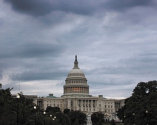 Storm clouds hang over Capitol Hill in Washington, Friday, Sept. 27, 2013.
