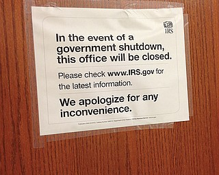 Signs were posted at the Internal Revenue Service office inside the Youngstown federal building Tuesday.