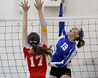 William D Lewis The Vindicator Jax Milton Erica Hughes(19) scores her 1,500 career kill during Wed 1--02-13 game with Western Reserve. Defending for WR is Katie Miggo(17).