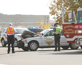 An Ohio State Highway Patrol trooper responding to a car accident Wednesday drove through a red light at the intersection of U.S. Route 224 and state Route 7, and collided with a Chevrolet Impala, which got pushed into a BMW.