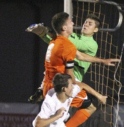 William D. Lewis The Vindicator  Canfield goalkeeper Jeff Joseph(03) geeen shirt, blocks a shot as Canfield's Alex Schill(4) is in on the action. Howland's Kyle Watson(4) is also airborne on the play.