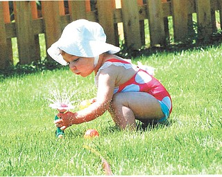 Natalie, daughter of Kristen and Dennis O'Hara of Youngstown, is having fun with her flower sprinkler. Sent by Grandma Lynne Drabison of Youngstown.