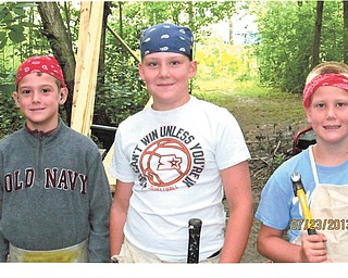 Grandsons Cain, Cody and Kyle Palovich, are preparing to help their dad and grandpa build a tree house at their home in Chardon. Sent by Grandmother Benita Palovich.