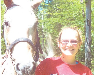 Samantha Toth, 14, had the time of her life this summer at The Flying W Ranch, a horseback riding camp in the Pennsylvania mountains. Sent by her mom, Roseann G. Toth of Austintown.