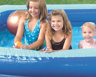 Granddaughters of Martie and Gary Kabetso of Canfield, Zoe and Olivia Kabetso and Chloe Guinter, are enjoying the pool at their grandparents home on July 4.
