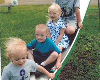 Colleen Close of Beloit took this photo of her grandchildren, from top to bottom, Carter, Lilah, Austin and Josiah Close, on the slide at Beloit Park.