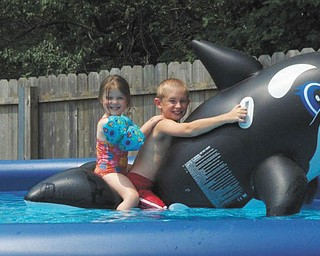 From Tina Buzzelli: Her son, Christopher Buzzelli of Mineral Ridge, and niece, Hailey Tomory of Canfield, are enjoying their ride on a shark five years ago!