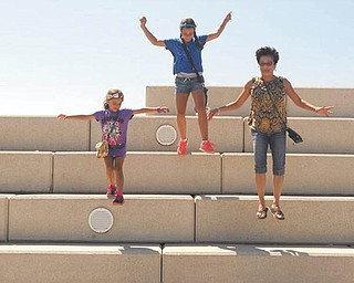 Aliya and Amaya Abeid of New Middletown are having fun at Voinovich Park in Cleveland with their Aunt Evelyn Filipkowski of Cleveland.